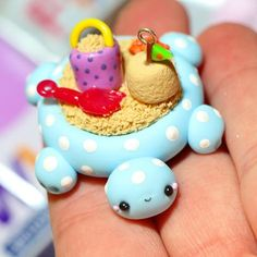 Hope everyone had a great weekend! I was bored this evening and decided to make a few charms. You can't really tell, but this is a turtle sandbox charm! I saw PitterPatterPolymer had made one for her etsy shop, so I wanted to make one too! Im not sure who to credit because I have no idea who made it first. So if you know please comment down below! Also, sorry for the terrible photo quality! I'll take a better picture tomorrow and delete this one! #polymerclay