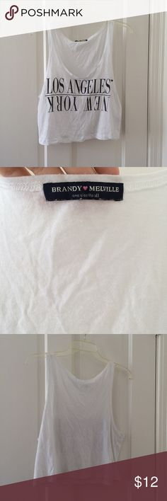 Brandy Melville Los Angeles/ New York tank top Super soft brandy Melville Los Angeles/ New York tank top. One size fits all. In good condition, no visible flaws! Sleeveless/croptop. Brandy Melville Tops Crop Tops
