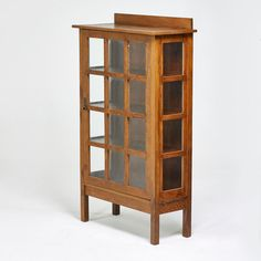 """L. & J. G. STICKLEY - Estimate: $1,200 - $1,800 - Single-door china cabinet with gallery top, Fayetteville, NY, ca. 1910; Quartersawn oak, hammered copper, glass; 60"""" x 36"""" x 15"""""""