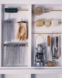 Is your garage a total mess? Here are 29 tips to declutter your garage this fall. For more garage organization ideas and storage tips, go to Domino. Shed Storage, Garage Storage, Storage Ideas, Tool Storage, Ribbon Storage, Hanging Storage, Outdoor Storage, Garage Organization Tips, Garden Organization