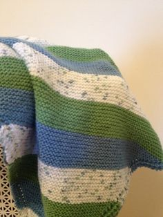 Lovely blanket for a little boy!  https://www.etsy.com/listing/152239563/hand-knit-baby-blanket-blue-green-and?ref=shop_home_feat