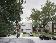 Located in Montreal, Tuan Vu and Jean François's sleek modern home is designed to balance the need for privacy while maximizing natural daylight. The exterior is clad in a single material to maintain a unified aesthetic. Residential Architecture, Modern Architecture, Aluminium Cladding, Metal Facade, Roof Beam, Architect House, Detached House, Building A House, Minimalism
