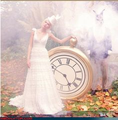Alice in Wonderland bridal photo shoot with giant pocket watch prop.  That watch would be beautiful over a mantle. Now I need to find a giant round clock, add the button and stem, then paint or gild <3