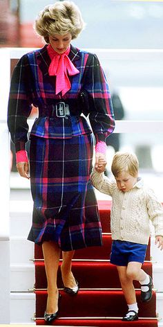 Princess Diana pays homage to the Scots by wearing a tartan plaid dress while disembarking from the royal yacht into Aberdeen with Prince William in 1985.