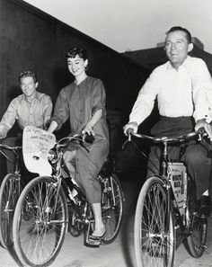 1954 Actors Danny Kaye and Bing Crosby go for a ride with Audrey during their visit to the set of Sabrina.