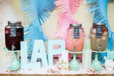 Giant crepe paper twirls as a backdrop for a drink station or party table - LOVE! #kidsparty #partydecor