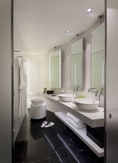 Not with vessel sinks but I love the third mirror as vanity space with shelves under the sinks
