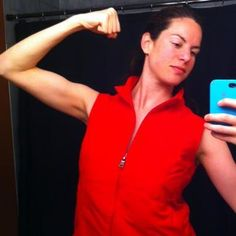 @WorldLillie showing off the guns in her red Travel Vest!