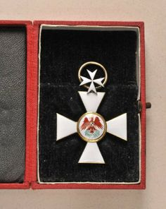 Prussian Red-Eagle-Order, model (1854-1879) 3rd class with Cross of the Order of St. John in case.