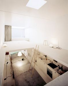 I love the possibilities of small spaces with tall ceilings :)