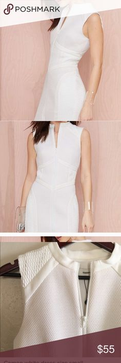 White cameo scuba dress by nasty gal. NWT. Sexy white scuba dress from cameo collective and nasty gal. Textured white scuba fabric. NWT. Bought on posh but too snug for my taste. Size small. Would fit a size 0/2. C/MEO Collective Dresses Midi
