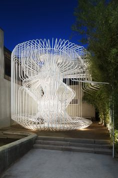 Whimsical Cage Redefines Public Space.  La Cage aux Folles (The Cage of Follies). Users enter through a gently contoured opening in the cylinder-shaped cage, which guides them into a modest open air labyrinth of white steel. The space offers an intimate semi-enclosed atmosphere, providing gentle protection from the elements. http://www.archdaily.com/542574/this-whimsical-cage-redefines-public-space/