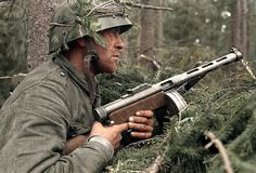 Esercito Finnico - A Finnish infantryman, with his Suomi sub-machine gun during the Battle of Vuosalmi in Karelian Isthmus, Finland as part of the Continuation War, between Finland and the Soviet Union. July (Note he wears a Czechoslovakia helmet)