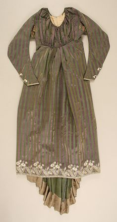 Round Gown ca. 1795; Met 1979.20a-g. Ensemble includes gown, separate stays, sleeveless spencer, and separate sleeves (probably left over from an earlier styling of the gown), all from the same striped silk satin fabric. The shape and length of the train and the hem facing are clearly seen in this flat view. A CF skirt seam splits the embroidery. The bodice has a CF opening with drawstrings at both neck and waist. Neckline drawstring extends to the small back piece.