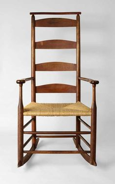 """Shaker Rocking Chair w/Cushion Rail - This rocking armchair is one of only three known early community chairs incorporating the unique Shaker innovation of the cushion rail.  The cushion rail is a round bentwood bar that traverses the two rear back posts to facilitate the hanging of a cushioned covering over the back slats.  This """"Elder's Chair"""" is constructed of maple & retains an old red orange finish.   New Lebanon, New York.  Circa1840.   H 44"""", seat W 18 1/8"""" (between posts) seat H…"""