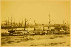 """Albumen print photograph by Charles Nettleton of Queen's Wharf, Melbourne, 1870s. The steamship """"Rob Roy"""" is at the quayside"""
