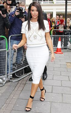 Kim Kardashian    Kim jazzed up her neutral look with a studded white top during a May 2012 appearance in London.