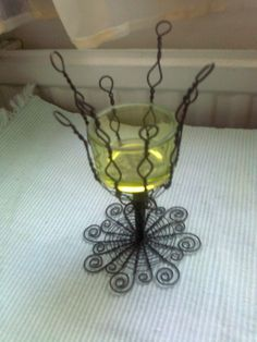 A wire candleholder.