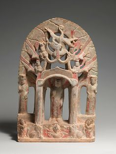 Votive Stele with Buddha and Bodhisattvas Period: Northern Qi dynasty Date: mid- 6th century Culture: China Medium: Limestone with pigment and gilding