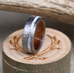 Wood lined wedding ring, handcrafted from jack daniels whiskey barrel, elk antler & hand-turned titanium. Handcrafted by Staghead Designs.