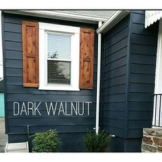 Dark blue house with walnut shutters and white window trim Wood Shutters Rustic exterior cedar shutters Shaker Exterior Paint Colors For House, Paint Colors For Home, Navy House Exterior, Exterior House Paint Colors, Siding Colors For Houses, Outdoor House Colors, Outside House Paint Colors, Houses With Shutters, Diy Exterior House Painting