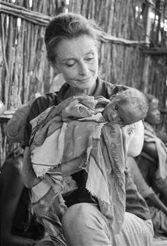 "Image from the Horn of Africa 1992  UNICEF Goodwill Ambassador Audrey Hepburn holds a severely malnourished child at a UNICEF-assisted feeding centre in Baidoa. ""For many it's too late, but for many, many more we can still be on time,"" said Ms. Hepburn, after witnessing the impact of famine on Somalia's children in 1992."