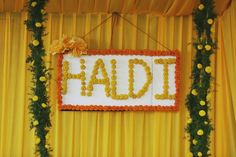 Haldi Decoration is defined by the colourful and quirky elements used! Check out these awesome haldi ceremony decoration ideas for your wedding in Desi Wedding Decor, Wedding Hall Decorations, Marriage Decoration, Wedding Props, Backdrop Decorations, Wedding Mandap, Flower Decorations, Indian Wedding Favors, Diwali Decorations