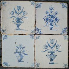 Kavel van 4 antieke tegels met Bloemen