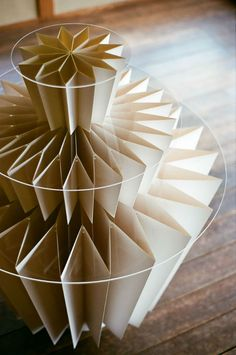 Kyoto-based interior designer Hiromitsu Konishi created this display system for Suzuki Shofudo, a 140-year old retailer of paper goods. The designer spent months studying the strengths, weakness, and flexibility of paper.    Eventually finding inspiration in the way Japanese fans open and collapse, Konishi created an entirely collapsible paper display system.