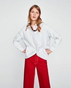 2436f90792 STRIPED SHIRT WITH SIDE BUTTON from Zara #zara #fashion #newarrivals # trending #spring #summer #fall #stripes #shirt #buttondownshirt #loose …