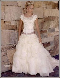 site with quite a few modest wedding dresses! May be handy someday...Wedding Dress - Style: Addilyn
