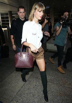 Taylor Swift always travels in style // eyelash-print blouse + top-handle purse + shorts + knee-high socks