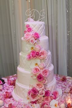 Wedding cake with cascading pink florals #lovely