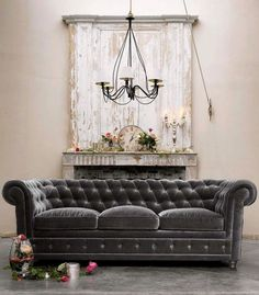 My favorite couch ever was a gray velvet Chesterfield sofa just like this.  I need it back.