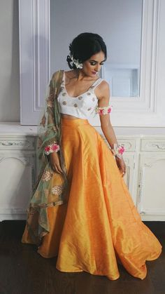 Orange skirt, white embellished top and net mint floral dupatta Pakistani Dresses, Indian Dresses, Indian Outfits, Indian Attire, Indian Wear, Indian Style, Ethnic Fashion, Asian Fashion, Orange Skirt Outfit