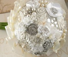 Brooch Bouquets are very popular right now.  Love the ribbon on the edge.  DIY is tempting.