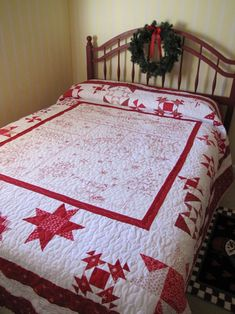 Snowman Redwork Christmas Quilt on red bed. This is the quilt I am working on now.
