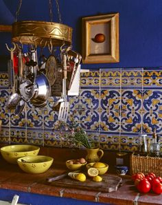Subtle accents with Mediterranean tile like these (or ones currently in home) could work well to give color to the kitchen or bathroom. More