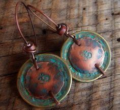 Earrings | Lynn Ferro. Chinese brass coins, copper with patina and Red Canyon Jasper heishi.