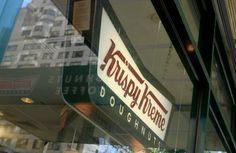A sign hangs in the window display of a Krispy Kreme Doughnuts Inc. store in New York on Monday, September 11, 2006. Photographer: Daniel Barry/Bloomberg News. Library Tag 05242011 Business