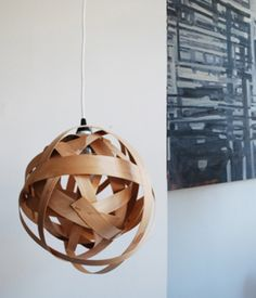 WOVEN LAMP Lighting your home with a flare of design doesn't have to be expensive. Give a handmade woven lamp to brighten another's living space while also adding a hanging piece of inspiration to their home.