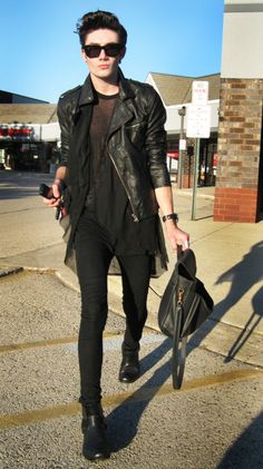 While wearing a tutu over black skinnies isn't my personal style, something about this look caught my eye! #laceandleather