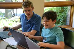 Identical twins Mathew and Andrew Pareles, 17, both seniors at Hewlett High…