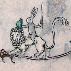 From the margins of an illuminated manuscript. A rabbit, armed ...