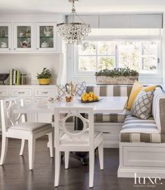 white breakfast nook with striped banquette seating source by