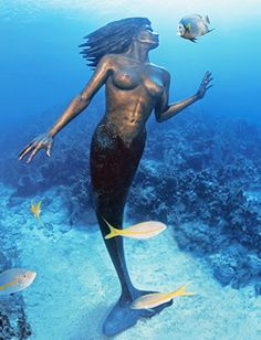 Amphitrite, The Mermaid, Sunset Reef, Grand Cayman - a 9 foot tall bronze mermaid standing 55 feet underwater at the edge of the reef. by Simon Morris