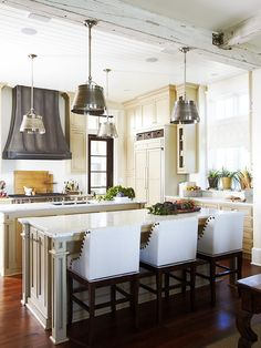 I love the white washed distressed beams and also the creamy color cabinetry.