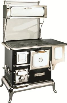 The Sweetheart Wood Cookstove  $5,700.  SKU: 2603 . Optional 5 gal reservoir includes a spigot to draw off hot water .   Every Sweetheart is shipped with a free lid lifter, poker and ash scraper.
