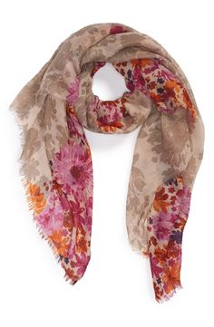 Love the floral print on this purple and pink fringe scarf.