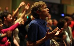 The marathoner Ryan Hall worshiping in Redding, Calif., at Bethel Church, which he joined with his wife, Sara, last August.